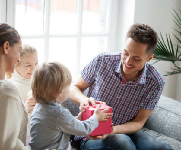 Children giving dad a gift