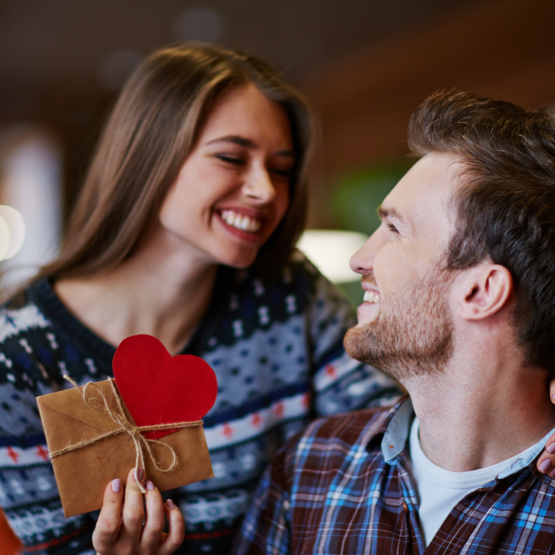Woman giving man Valentine's Day gift card
